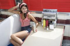 Woman Sitting At Diner Booth - stock photo