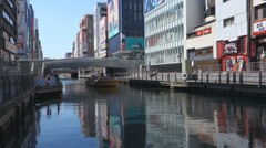 Cruises boat on river in Dotonbori,Osaka Stock Footage