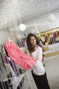 Woman Holding Pink Sleeveless Top - stock photo