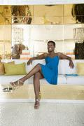 Happy Woman Sitting In A Lavish Store - stock photo