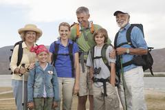 Happy Family With Backpacks Stock Photos