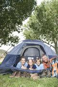 Family Of Four Smiling In Tent Stock Photos