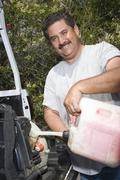 Man Fuelling Lawn Mower Stock Photos