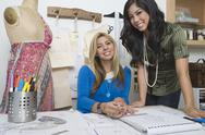 Stock Photo of Fashion Designers At Desk