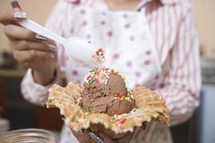 Female Preparing Chocolate Ice-Cream In Waffle Stock Photos