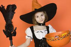 Preadolescent Girl In Witch Costume Stock Photos