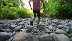 Glide Cam Male Walking Over Rocks - stock footage