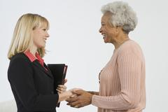 Happy Senior Woman Meeting Financial Advisor - stock photo