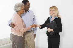 Financial Advisor Meeting Senior Couple Stock Photos