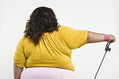 An Obese Woman Exercising - stock photo