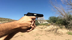 Firing a Polish 9mm Makarov in the Desert 120fps 3720 - stock footage
