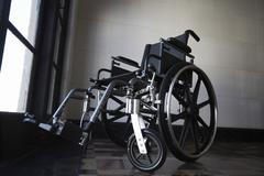 Wheelchair In Empty Room - stock photo