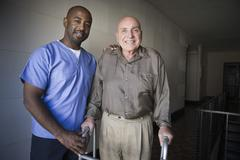 Healthcare Worker With Elderly Man - stock photo