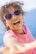 mixed race african american girl child sunshine sunglasses - stock photo
