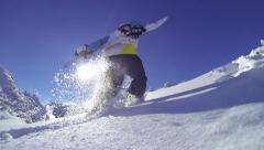 Snowboarder hiking in mountains Stock Footage