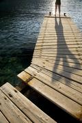 Stock Photo of Person Standing On Jetty