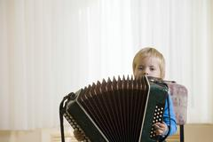 Boy Playing Accordion Stock Photos