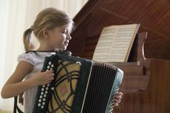 Girl Playing Accordion Stock Photos