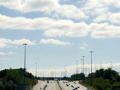 Highway under partly cloudy sky Stock Photos