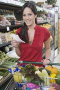 Young Woman Food Shopping In Supermarket - stock photo