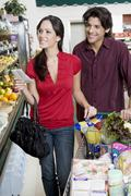 Couple Food Shopping In Supermarket - stock photo