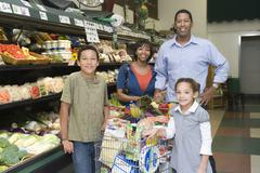 Family Of Four Shopping In Supermarket Stock Photos