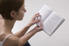 Stock Photo of Young Woman Reading Book