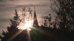 Silhouette trees and church Stock Footage
