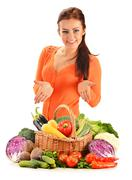 young woman with assorted vegetables isolated on white background - stock photo