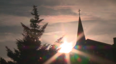Sunbeams and church - stock footage