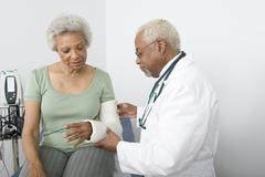 Doctor Checking Patient's Fractured Hand Stock Photos