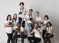 Multiethnic Group Of People With Cameras Stock Photos