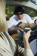 Man Assaults Woman With Firearm Through Car Window Stock Photos