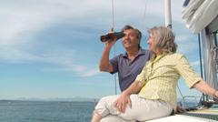 Mature Sailing Couple Using Binoculars Stock Footage