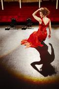 Beautiful Woman In Red Gown On Stage Stock Photos