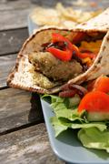 Flat bread with falafel and hummus Stock Photos