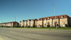 Road Traffic and Townhouses, Slow Shutter Stock Footage