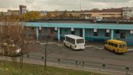 Stock Video Footage of Bus station, autumn.  Dolly, time lapse shot