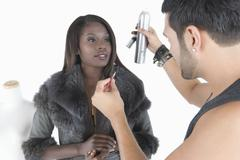 Hair Stylist Makes Adjustments To Model In Fur Jacket Stock Photos