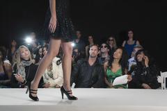 Model In High Heels Against Spectators Stock Photos
