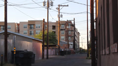Pan Left Alley to Brick Building Stock Footage