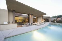 Stock Photo of Pool And Seating Area Against House