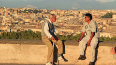 Elderly man with his carer in Rome Stock Footage
