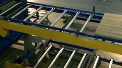 Conveyor of moving wooden beams on machine Stock Footage