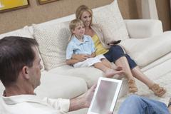 Family Having Leisure Time At Home - stock photo