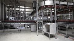 Plastic beer bottles moving on conveyor Stock Footage