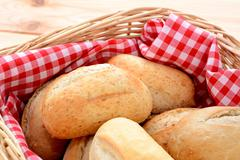 closeup of appetising crusty petit pain in a basket - stock photo