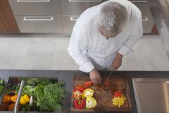 Stock Photo of Chef Dicing Red And Yellow Bell Peppers
