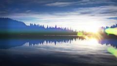 Brilliant reflective cascade mountain lake with lighting effects Stock Footage