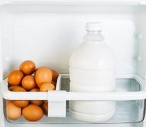 fresh food on refrigerator door shelf - stock photo